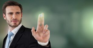 Businessman touching air glow. Digital composite of Businessman touching air glow Stock Image