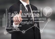 Businessman touching analytics royalty free stock image