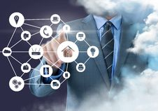 Businessman touching applications interface against clouds. Digital composition of businessman touching applications interface against clouds Stock Images