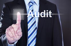 Businessman touching audit button. Midsection of businessman touching Audit button on virtual screen Stock Photos