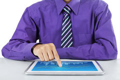 Businessman touching business chart at digital tablet Royalty Free Stock Photos