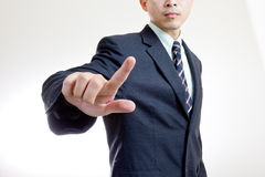 Businessman touching button Stock Photo