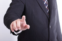Businessman touching button Stock Photography