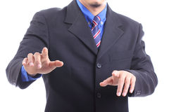 Businessman touching button with white background Royalty Free Stock Photography