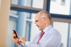 Businessman Touching Cell Phone Screen Stock Photo
