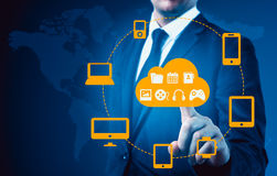 Businessman touching a cloud connected to many objects on a virtual screen, concept about internet of things Stock Images