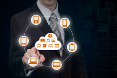 Businessman touching a cloud connected to many objects on a virtual screen, concept about internet of things Royalty Free Stock Photo