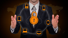 Businessman touching a cloud connected to many objects on a virtual screen, concept about internet of things Royalty Free Stock Photos