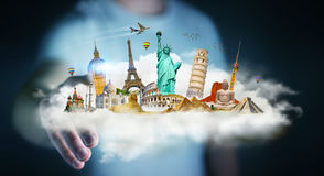 Businessman touching a cloud full of famous monuments with his f. Businessman on blurred background touching a cloud full of famous monuments with his finger 3D Stock Image