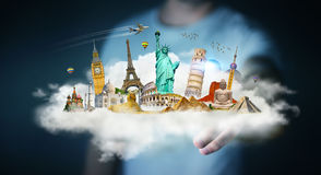 Businessman touching a cloud full of famous monuments with his f. Businessman on blurred background touching a cloud full of famous monuments with his finger 3D Royalty Free Stock Images