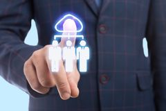 Businessman touching cloud icon on transparent display. With index finger as futuristic concept royalty free stock image