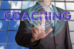 Coaching text with businessman. Businessman touching coaching text by finger Stock Images