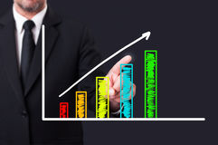 Businessman touching colorful growing columns on digital web scr Stock Images