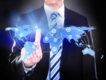 Businessman touching connected world map Stock Photos