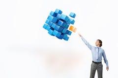 Businessman touching cube Stock Photo