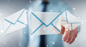 Businessman touching 3D rendering flying email icon with his fin Stock Photos