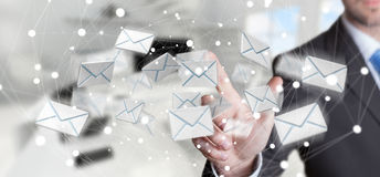 Businessman touching 3D rendering flying email icon with his fin. Businessman on blurred background touching 3D rendering flying email icon with his finger Royalty Free Stock Photo