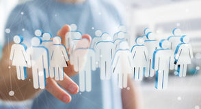 Businessman touching 3D rendering group of people with his finge Royalty Free Stock Photos
