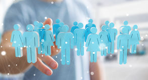 Businessman touching 3D rendering group of people with his finge Stock Photography