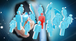 Businessman touching 3D rendering group of people with his finge Stock Photo