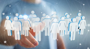 Businessman touching 3D rendering group of people with his finge Royalty Free Stock Photography