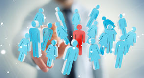 Businessman touching 3D rendering group of people with his finge Royalty Free Stock Images