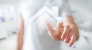 Businessman touching 3D rendering icon house with his finger. Businessman on blurred background touching 3D rendering icon house with his finger Royalty Free Stock Image