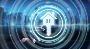 Businessman touching 3D rendering icon house with his finger. Businessman on blurred background touching 3D rendering icon house with his finger Stock Photos