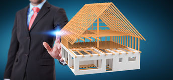 Businessman touching 3D rendering unfinished plan house with his. Businessman on blurred background touching 3D rendering unfinished plan house with his finger Royalty Free Stock Images