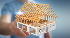 Businessman touching 3D rendering unfinished plan house with his Stock Image