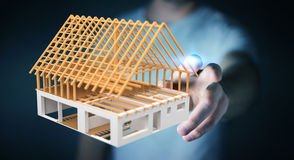 Businessman touching 3D rendering unfinished plan house with his Stock Photo