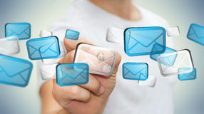 Businessman touching digital email icons '3D rendering'. Businessman touching digital email icons with a pen '3D rendering Stock Images