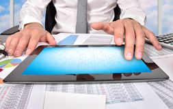 Businessman touching digital tablet Royalty Free Stock Image