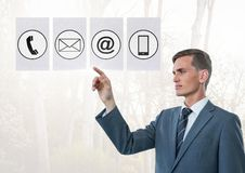 Businessman touching digitally generated connecting icons Royalty Free Stock Photo