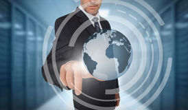 Businessman touching earth on futuristic interface Royalty Free Stock Photos