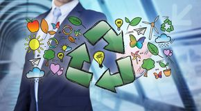 Businessman touching ecology interface with arrow recycling logo. View of a Businessman touching ecology interface with arrow recycling logo Stock Photos