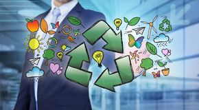 Businessman touching ecology interface with arrow recycling logo. View of a Businessman touching ecology interface with arrow recycling logo Stock Images