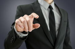 Businessman touching empty virtual screen Stock Images