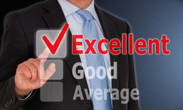 Businessman touching excellent button Royalty Free Stock Photography