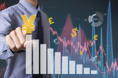 Businessman touching financial analysis graph with yen signs Royalty Free Stock Photo