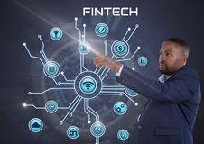 Businessman touching Fintech with various business icons interface Stock Photos