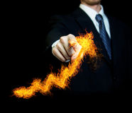 Businessman Touching a Fire Arrow Stock Photos