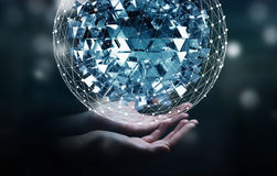 Businessman touching flying abstract sphere with shiny cube 3D r Stock Image