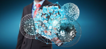 Businessman touching flying abstract sphere with shiny cube 3D r. Businessman on blurred background touching flying abstract sphere with shiny cube 3D rendering Stock Photography