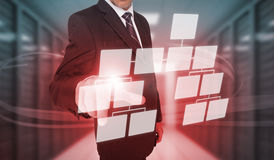 Businessman touching futuristic flowchart interface Royalty Free Stock Photos