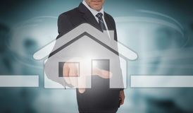 Businessman touching futuristic house interface Royalty Free Stock Photography