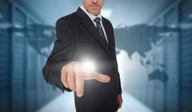 Businessman touching futuristic interface with world map on back. Businessman touching futuristic interface with world map and data center on background Stock Photos