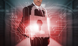 Businessman touching futuristic lock and circuit board interface Royalty Free Stock Photography