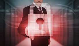 Businessman touching futuristic red lock touchscreen Royalty Free Stock Photo