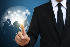 Businessman touching global network. communication and social m stock image